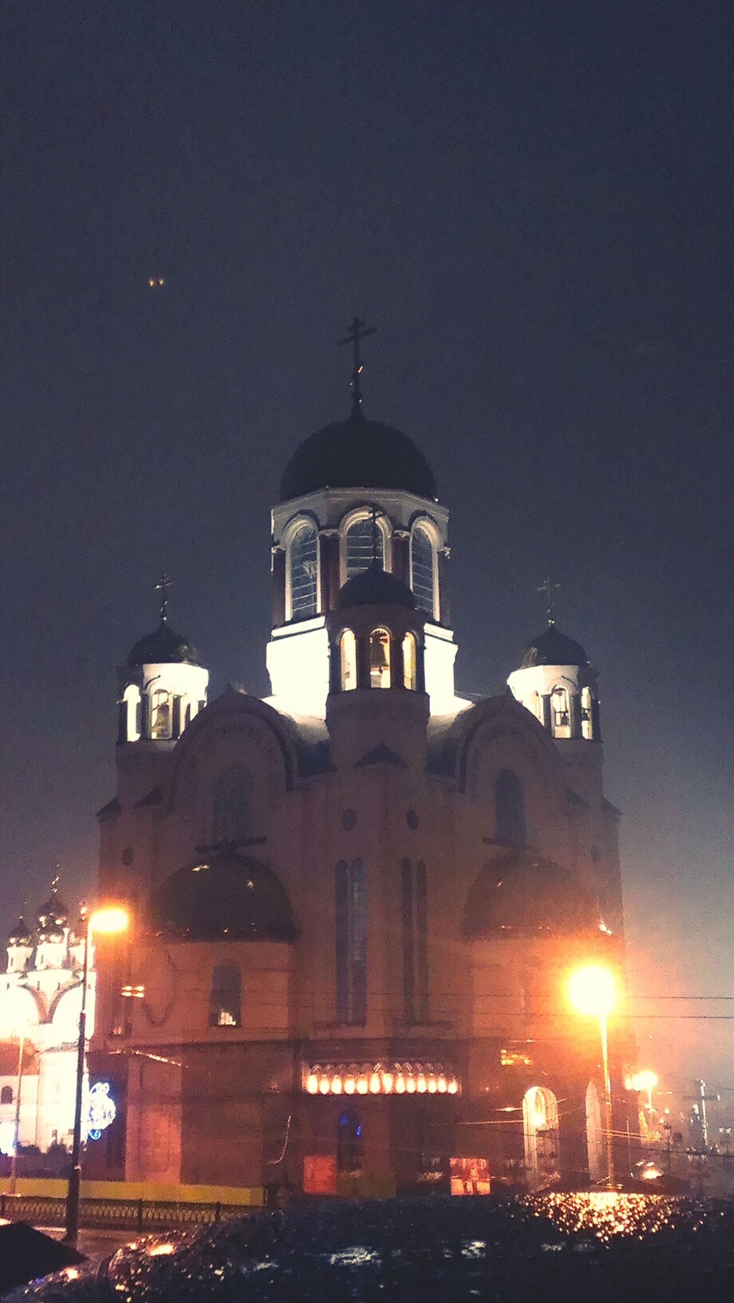 building exterior, architecture, built structure, illuminated, night, church, religion, street light, place of worship, low angle view, sky, dome, city, spirituality, lighting equipment, street, outdoors, building