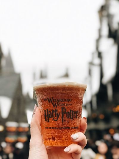 Harrypotter Human Hand Hand Human Body Part Holding Real People Focus On Foreground One Person Drink Unrecognizable Person Personal Perspective Refreshment Lifestyles Finger Food And Drink Body Part Human Finger Human Limb Close-up Glass Architecture