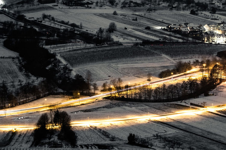 High angle view of snow covered road at night