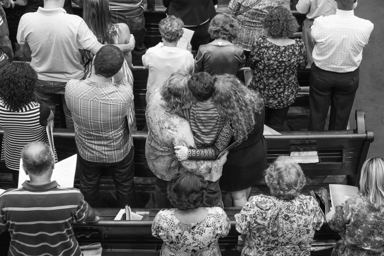 High angle view of people praying at church