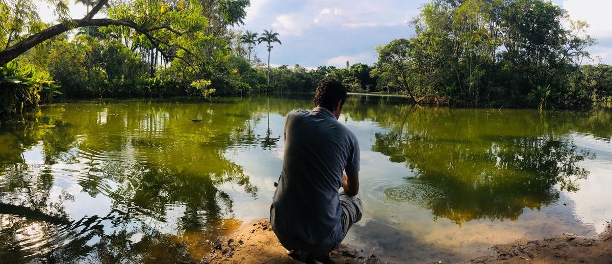 Tropical Rainforest Tropical Flowers Tropical Paradise EyeEmNewHere Water Tree Plant Real People Reflection Lake Nature Lifestyles Sky Outdoors