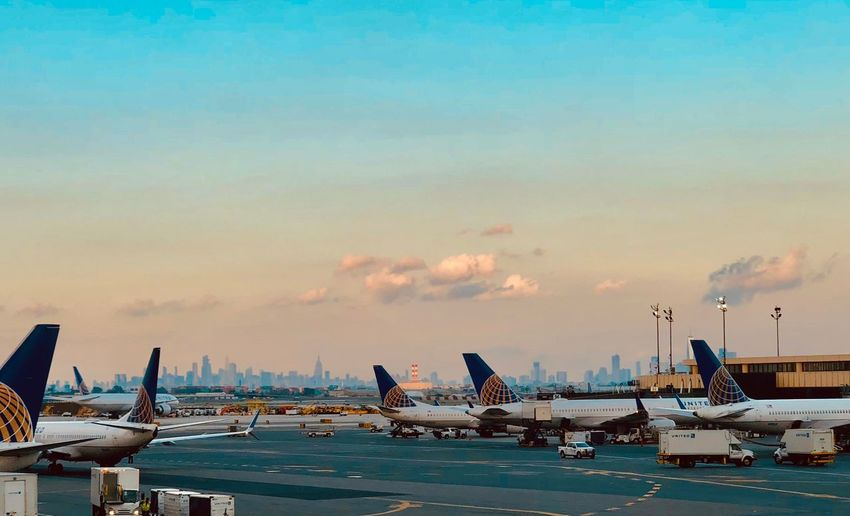 Planes and city Water Sky Transportation Mode Of Transportation Built Structure No People City Cloud - Sky Sunset