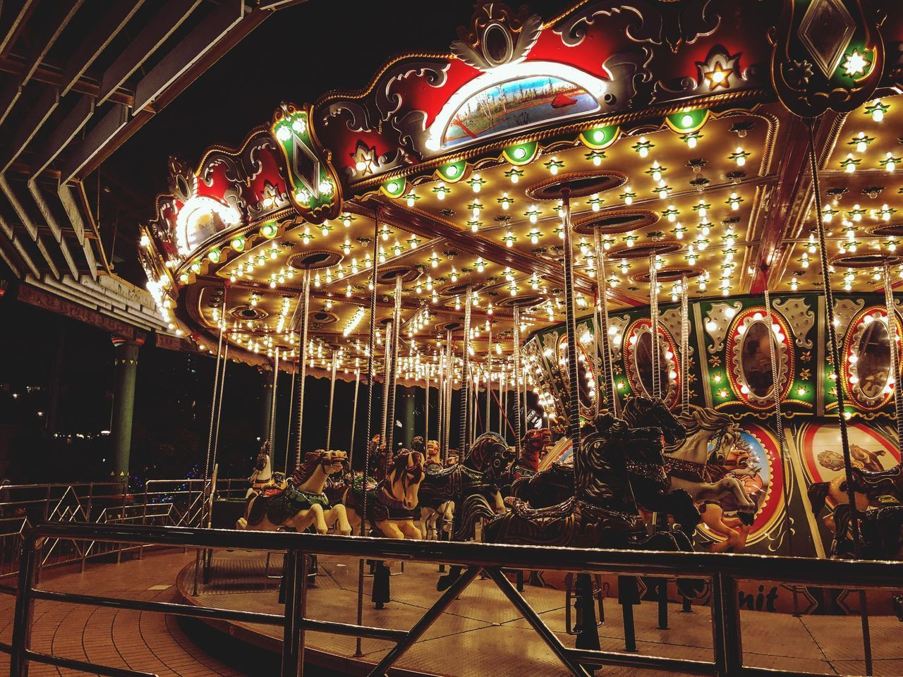 amusement park ride, amusement park, illuminated, carousel, arts culture and entertainment, night, animal representation, leisure activity, representation, lighting equipment, glowing, enjoyment, fun, no people, carousel horses, merry-go-round, light, outdoors, architecture, recreational pursuit