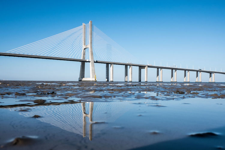 bridging the gap Reflection Reflections Reflections In The Water Longest Bridge Tagus River Tagus Estuary Cable-stayed Bridge Bridge - Man Made Structure Steel Cable Engineering Tide Bridge Bay Of Water Reflection Lake