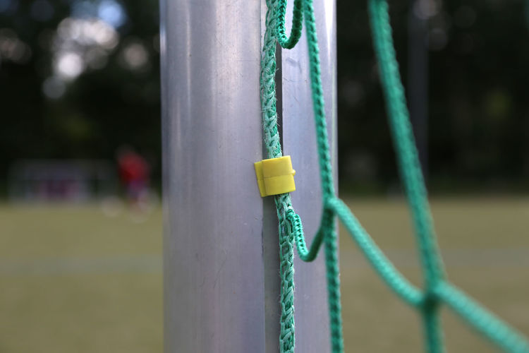 Close-up of net in soccer field