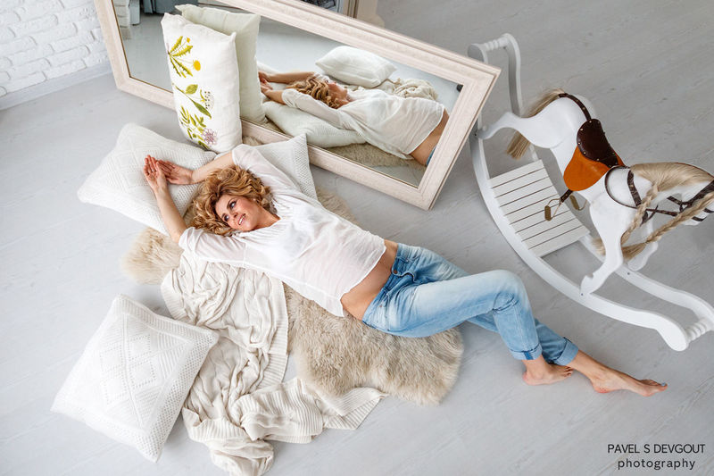 Adult Blond Hair Children Only Day Full Length High Angle View Indoors  Lying Down Lying On Back One Person People Pillow Smiling
