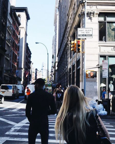 NYC City Building Exterior Street Architecture Built Structure Rear View Person City Life Men City Street Road Car Lifestyles Transportation Traffic Zebra Crossing Leisure Activity Medium Group Of People Rush Hour First Eyeem Photo