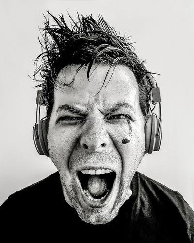 Portrait of screaming man wearing headphones
