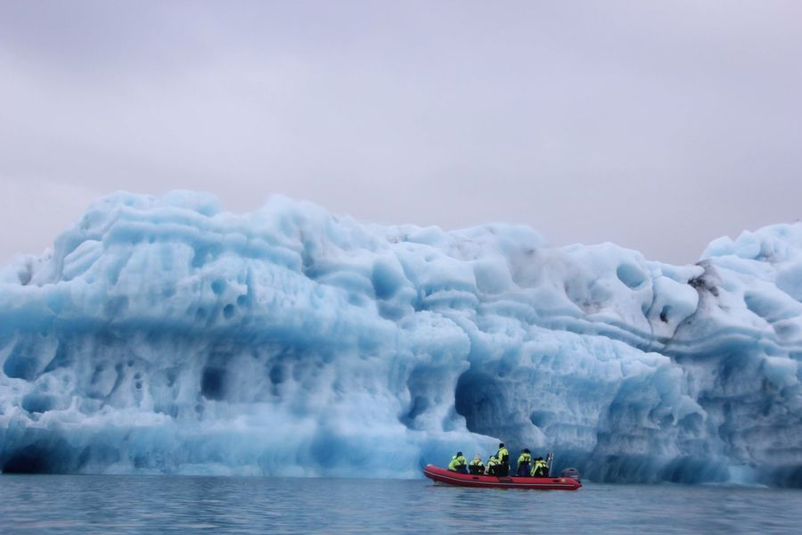 Beauty In Nature Blue Boat Iceberg Jökulsárlón Nature Outdoors Waterfront Lost In The Landscape