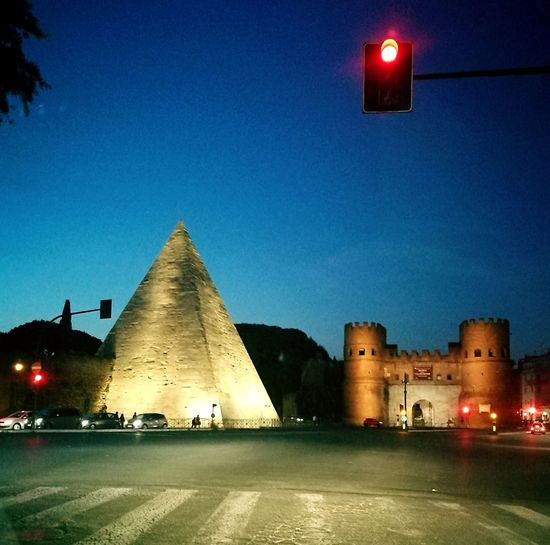camminando nella storia Graphicarts Piramide Cestia Mypic Picoftheday Nightphotography Instsgood Instagramer ınstagram City Illuminated Clear Sky Pyramid History Multi Colored Sky Architecture Built Structure Building Exterior Archaeology Old Ruin Civilization