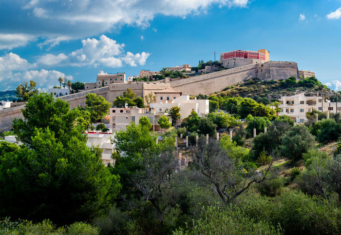 View of the Dalt Vila of Eivissa. Spain Ancient Architecture Architecture Balearic Islands Castle City Cloud - Sky Dalt Vila Europe Fort Fortification Fortified Wall Heritage Hillside History Ibiza Ibiza, Spain Landmark Landscape Outdoors Scenery SPAIN Spanish Sunny Day Town Trees