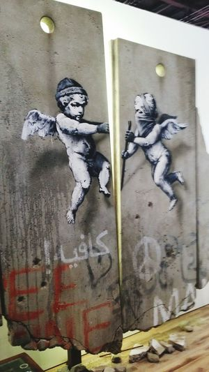 Banksy Representing Palestine At The World Travel Market, ExCel London, November 2018. Displaying A Specially Created Original Artwork Of A Replica Dividing Wall Section. London Excel Center World Travel Market Wtm 2018 Banksy Banksy Original Display Dividing Wall Palestine Travel Expo Close-up Architecture Built Structure ArtWork