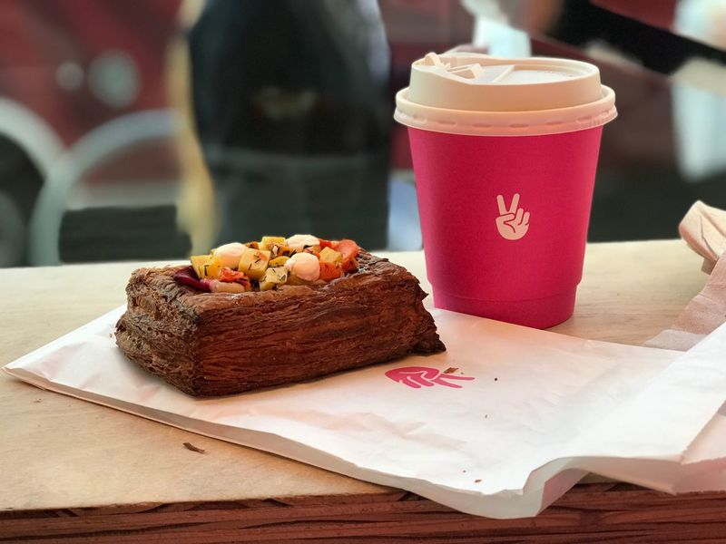 Mr Holmes Bakehouse Peace Sign  Peace Sign - Gesture Croissant Pink Coffee Food And Drink Table Coffee - Drink Coffee Cup Freshness Indoors  Food Focus On Foreground No People Drink