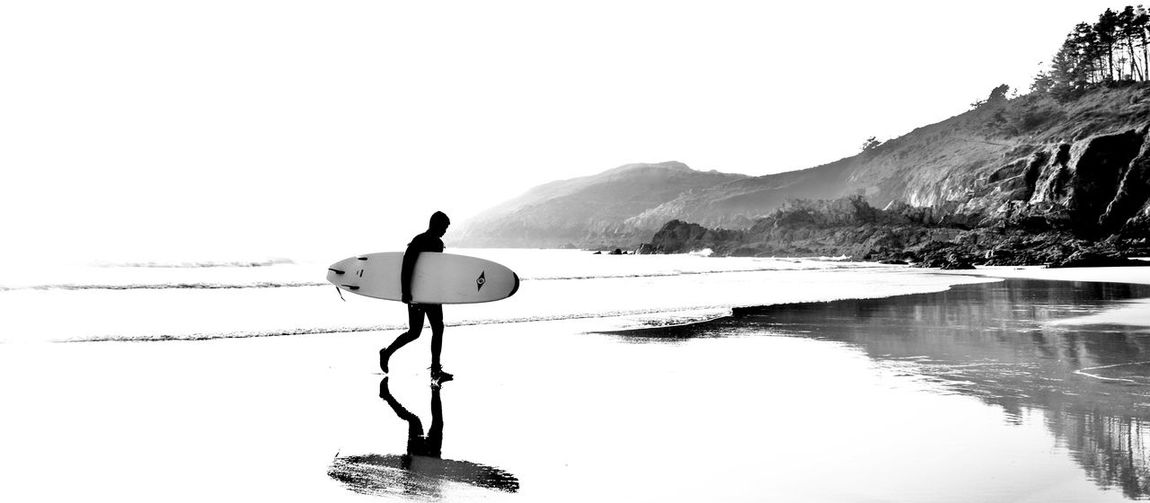 Surf au Minou Brittany Silhouette Surf Beach Beachphotography Beauty In Nature Bnw Bnw_captures Bnw_collection Clear Sky Day Lifestyles Nature Non-urban Scene One Person Outdoors Real People Reflection Reflets Scenics - Nature Sky Surfing Tranquil Scene Tranquility Water #FREIHEITBERLIN The Great Outdoors - 2018 EyeEm Awards Summer Sports