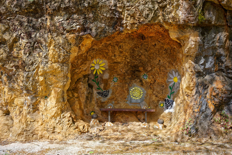 Bus stop near Novales, Cantabria Cantabria Novales Rock Wall Art Art Built Structure Bus Stop Cave Flowers Handmade Hole No People Rock - Object Rock Formation Rough Time