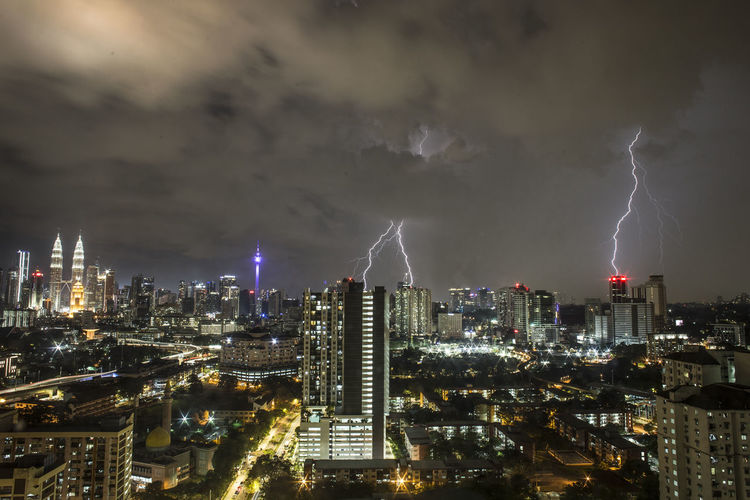 Lightning strike of Kuala Lumpur, Malaysia Building Exterior City Built Structure Architecture Cloud - Sky Illuminated Sky Building Night Cityscape Office Building Exterior Skyscraper Storm Modern Lightning No People Tall - High Urban Skyline Nature Power In Nature Outdoors Financial District  Lightning Strikes 17.62°