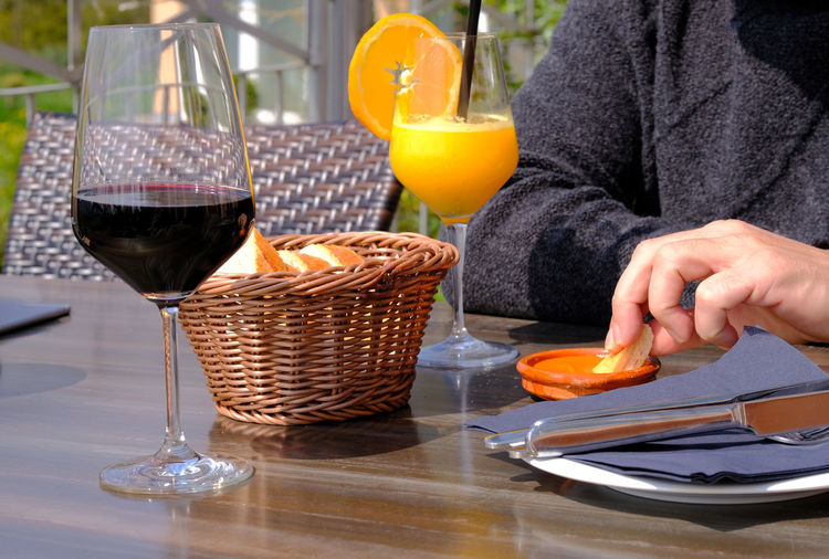 Bread Basket Food And Drink Healthy Eating Healthy Lifestyle Human Body Part Human Hand Leisure Lunch Mojo Rojo Orange Orange Juice  Outdoors Red Wine In The Glas Snack Time! Spare Time Sunny Day Table Live For The Story Paint The Town Yellow