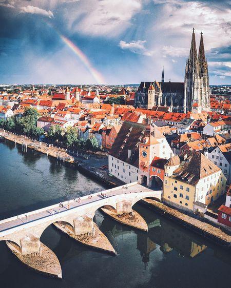 Aerial view of buildings in town against sky