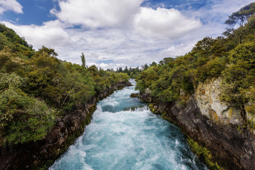 Panoramic view of Huka Falls, New Zealand NZ Beauty In Nature Cloud - Sky Day Environment Flowing Flowing Water Forest Huka Falls Land Motion Nature New Zealand Newzealand No People Outdoors Plant Power In Nature River Scenics - Nature Sky Tranquil Scene Tranquility Tree Water