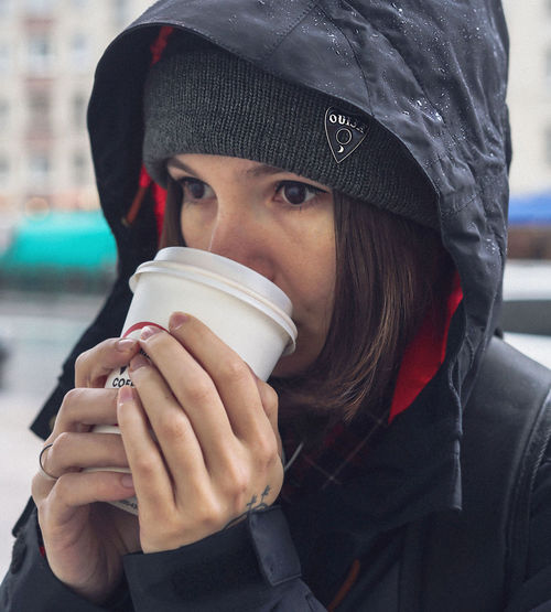 moody walk One Person Headshot Portrait Real People Clothing Drink Lifestyles Holding Drinking Food And Drink Leisure Activity Refreshment Winter Hat Cup Close-up Focus On Foreground Adult Warm Clothing