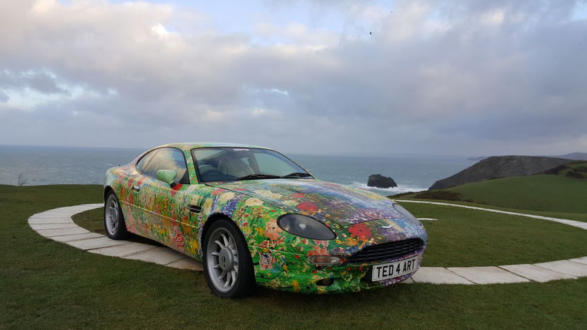 Very colourful car...Ted Stourton, local resident artist...💙💜💛❤ Aston Martin Car Colourful Artist Enjoying The View From My Point Of View Check This Out Enjoying Life The Purist (no Edit, No Filter) Onholiday Relaxing Streamzoofamily Cornwall Tintagel Rugged Beauty Atthebeach EyeEm Best Shots Taking A Break Ladyphotographerofthemonth Holiday Friends Samsung Galaxy S6 Edge+ Playing With My Phone. ..
