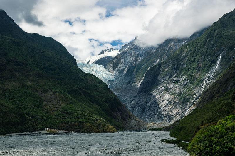 Scenic view of mountains against sky at franz josef glacier new zealand