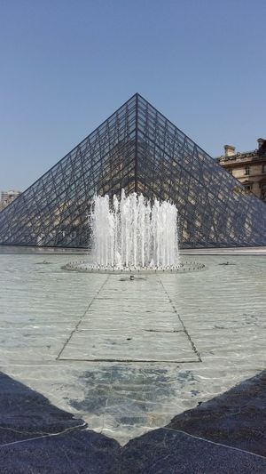 History Monument Travel Destinations Architecture Day No People Outdoors Sky City Pyramid Pyramide Du Louvre Water Water Jet EyeEmNewHere Tourism The Week On EyeEm