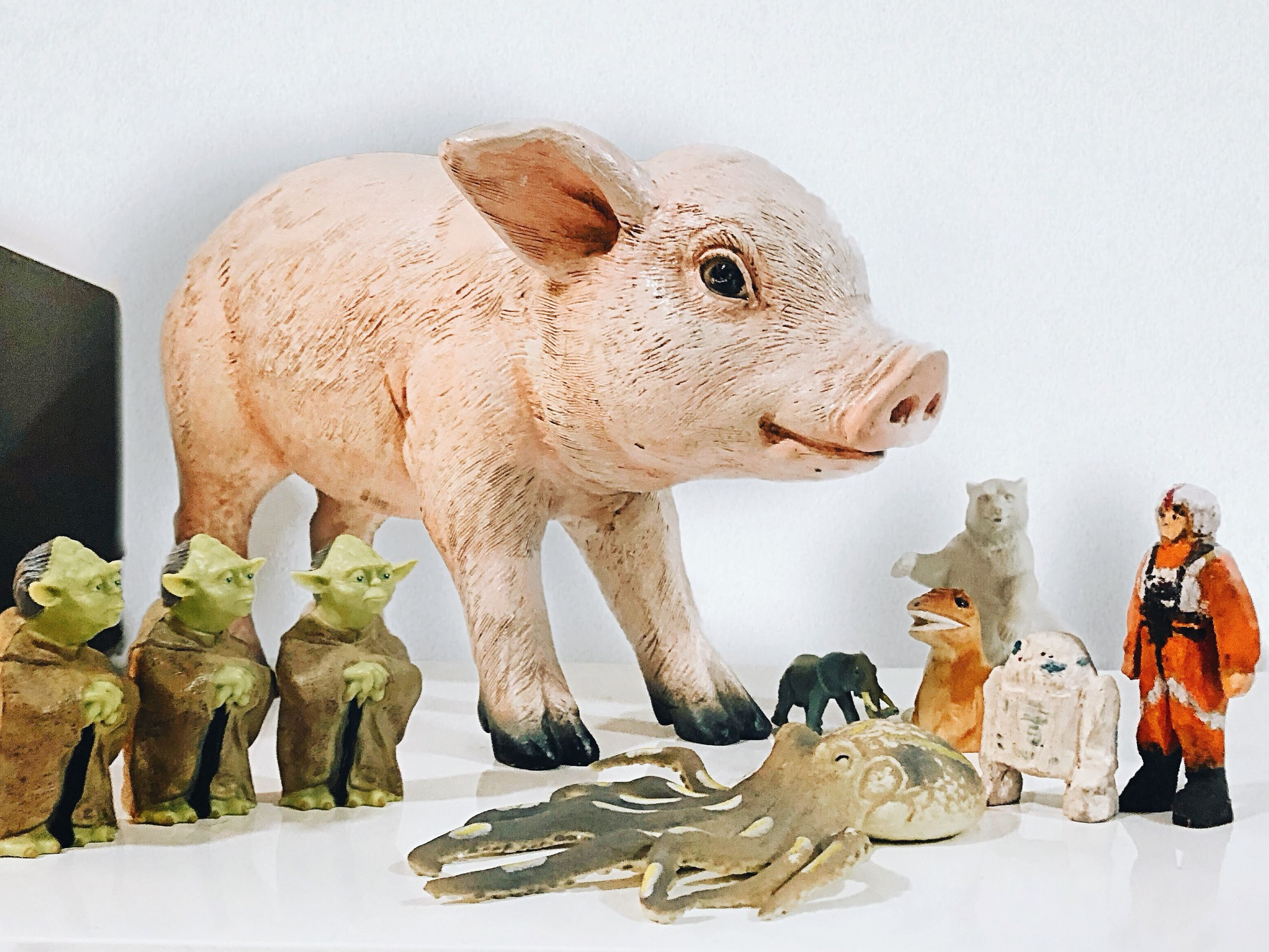representation, indoors, mammal, art and craft, no people, sculpture, domestic animals, group of animals, livestock, human representation, white background, statue, male likeness, vertebrate, animal wildlife, studio shot, herbivorous