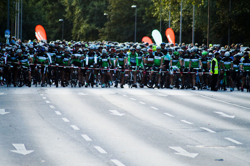 Cyclists waiting at starting line on road