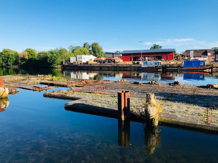 Holtenau II Urban Water Sky Nature Architecture Reflection Built Structure Clear Sky Day Moored Tree Transportation Copy Space Plant Outdoors Building Exterior Blue Waterfront No People Nautical Vessel Canal