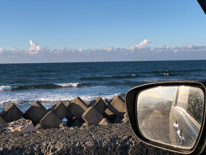 Holiday driving along the beach Sky Water Sea Transportation Reflection Scenics - Nature Mode Of Transportation Land Vehicle Sunlight Glass - Material Side-view Mirror Horizon Horizon Over Water Outdoors No People Vehicle Interior Nature Day Beauty In Nature