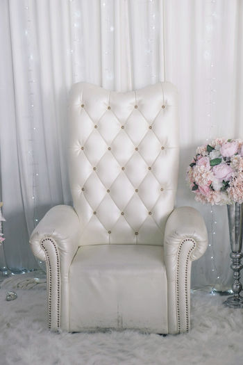 Wedding chair Absence Celebration Chair Curtain Decoration Domestic Room Empty Flower Flower Arrangement Flowering Plant Furniture Home Home Interior Indoors  Luxury Nature No People Plant Seat Table Vase White Color
