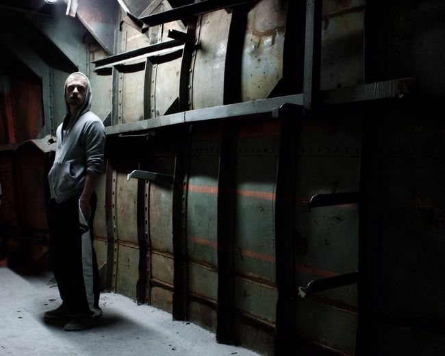 Industrial Face In The Dark Hooded Man Hooded Streetphotography One Man Man In The Shadows Dark Scenery Steel