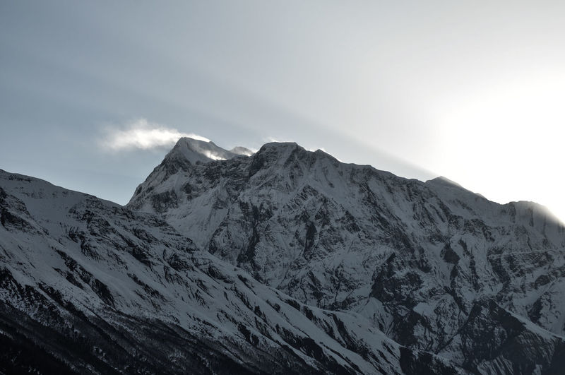 Annapurna Conservation Area Nepal Trekking Travel Destinations Travel Sunset Tranquility Tranquil Scene Blowing Snow Mountain Snow Winter Cold Temperature Mountain Peak Snowcapped Mountain Sky Landscape Mountain Range Cloud - Sky