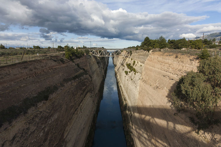Corinth Canal near Gefira Isthmou, Greece Architecture Beauty In Nature Bridge Built Structure Canal Cloud - Sky Corinth Corinth Canal Day Europe Gefira Isthmou Greece Landscape Man Made Nature No People Outdoors Passage River Scenics Sky Tranquil Scene Transportation Tree Water