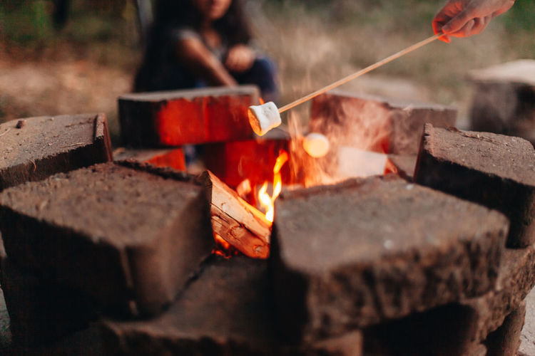 Making smores at home outdoors at the fire pit