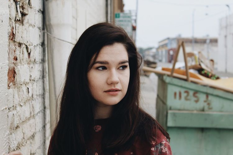 Portrait Looking At Camera One Person Front View Young Adult Focus On Foreground Architecture Day Real People Leisure Activity Young Women Beautiful Woman Headshot Close-up Building Exterior Outdoors Lifestyles