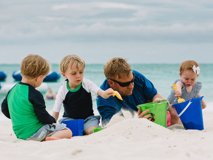 Baby Beach Brother Childhood Dad Family Father Fatherhood Moments Happiness Love Playing Sand Sandcastle Siblings Sister Togetherness Vacations Ocean EyeEmNewHere