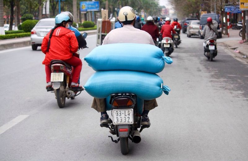 Making A Living Street Photography The Courier Delivery Man Hanoi, Vietnam Balance Moto
