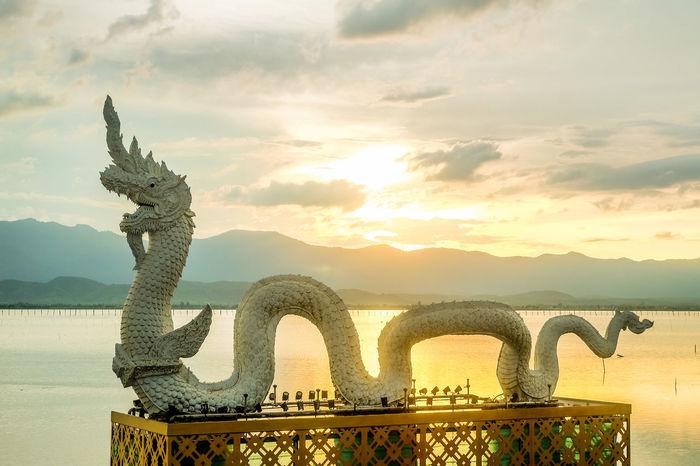 Phayao Art And Craft Cloud - Sky No People Orange Color Outdoors Sculpture Sky Statue Sunset Water กว๊านพะเยาแหล่งชีวิต