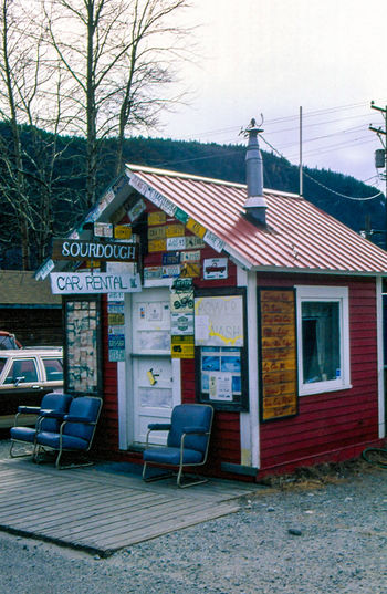 alaska Alaska Architecture Built Structure Car Rental Day Information Information Sign No People Outdoors Road Sign Sky The Way Forward Tree