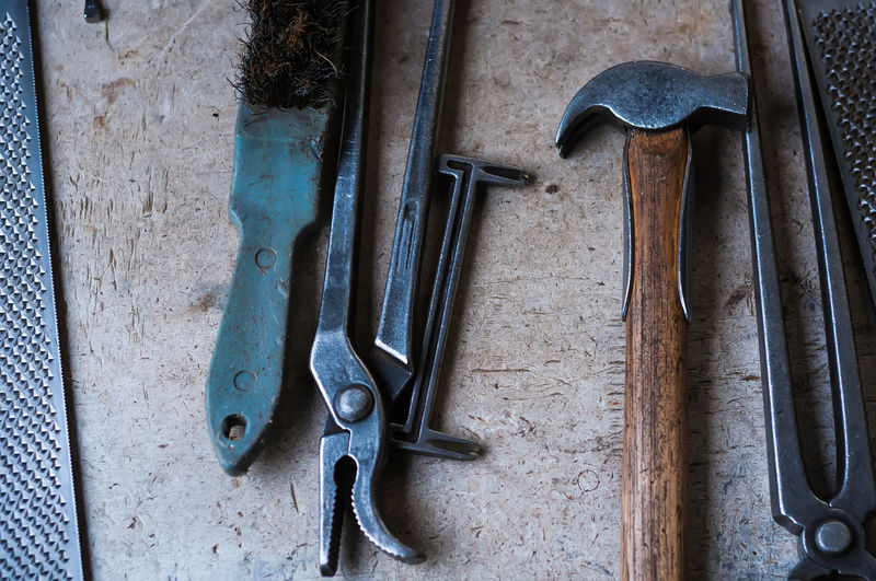 High angle view of work tools on table in workshop