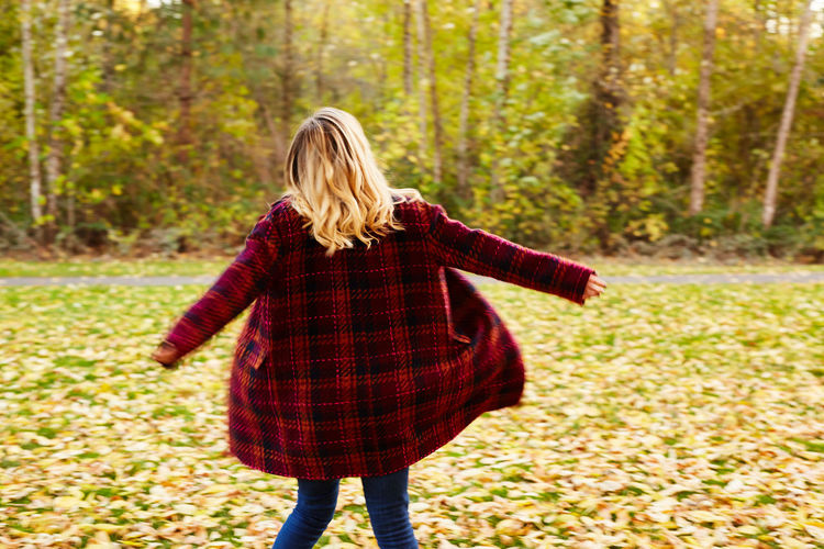 Adult Adults Only Autumn Blond Hair Casual Clothing Day Forest Jacket Leaf Leisure Activity Long Hair Nature One Person One Woman Only One Young Woman Only Only Women Outdoors People Rear View Standing Tree Walking Women Young Adult Young Women