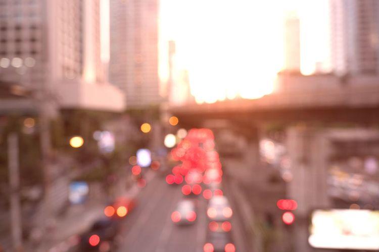 Defocused image of illuminated road at night