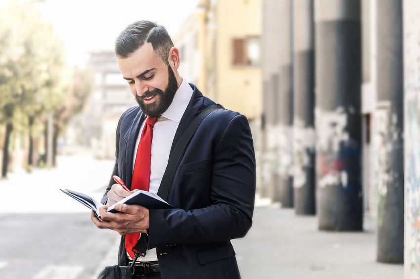 Model: Roberto Materiale Architecture Beard Business Business Person Businessman City Communication Connection Day Focus On Foreground Formalwear Holding One Person Outdoors Suit Technology Well-dressed Wireless Technology Young Adult Young Men