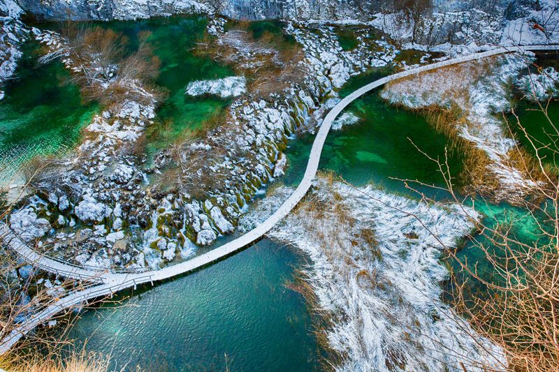 Plitvice lakes in winter Water Plitvice National Park Lika Croatia Plitvice Winter Snow Ice Cold Temperature Water No People Day High Angle View Nature Green Color Swimming Pool Outdoors Waterfront Full Frame Beauty In Nature Close-up Tranquility Turquoise Colored Reflection