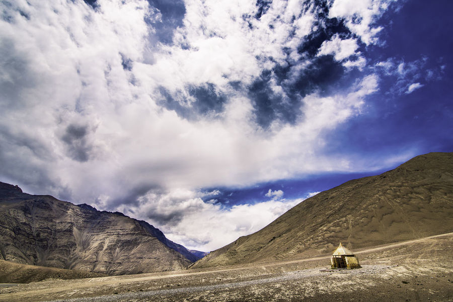 All alone India Indian Terrain Ladakh NewToEyeEm Perspectives On Nature Beauty In Nature Cloud - Sky Clouds And Sky Day Dji Landscape Life On The Hills Mountain Mountain Life Mountain Range Nature One Person Outdoors People Real People Scenics Sky Skyporn Tranquil Scene Tranquility