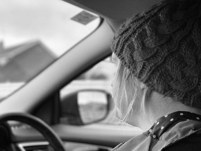 Rear view of man seen through car