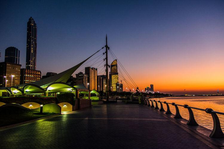 City at seaside during dusk