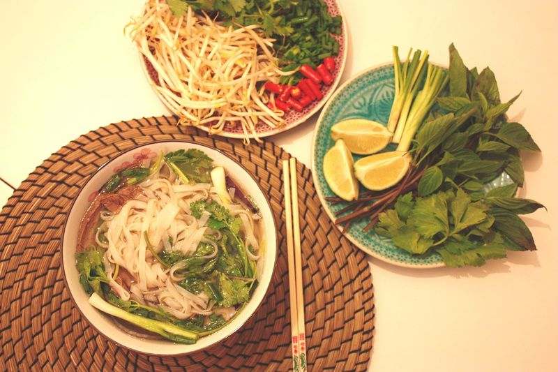 High angle view of noodles and vegetables on table